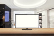 isolated tv on wooden desk in office background for mock up presentation