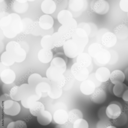 Fototapety, obrazy: White and gray bokeh winter holidays background for greeting cards. Blurry sparkling lights.