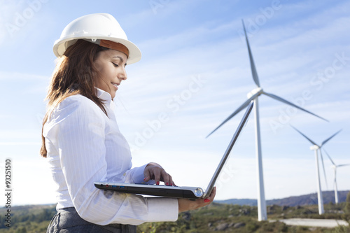 Fotografie, Obraz  Environmental engineer with a laptop at wind farm