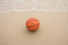 Basketball Ball On The Beach
