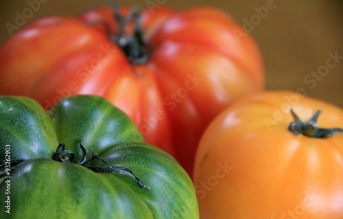 Fotografering  Trio of tomatoes in colorful red,yellow and green variety