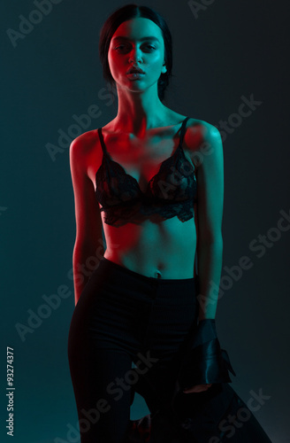 Fotografia, Obraz  fashion girl red blue light in studio