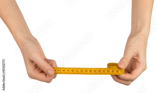 Humans arms holding tape measure - Buy this stock photo and