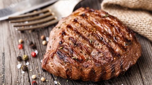 Photo Stands Steakhouse Beef steak on a wooden board