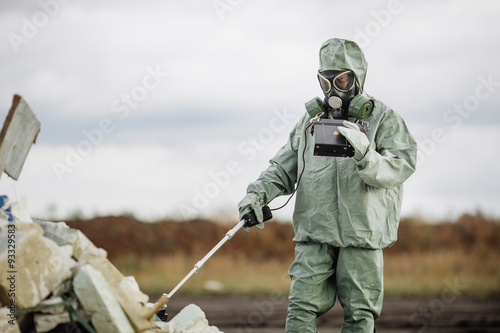Fotografie, Obraz  Scientist (radiation supervisor) in protective clothing and gas