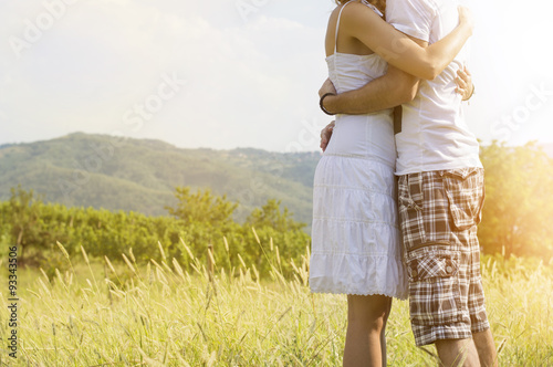 Fotografie, Obraz  Loving couple hugging strong outdoors with no faces shown