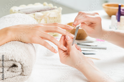 Manicure treatment at nail salon