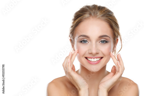 plakat Young woman touching her face isolated on white background