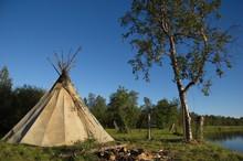 Traditional Hut To Smoke Fish On The River. Ponoy River, Kola Peninsula, Russia.