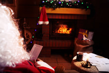 Santa Claus Reads Letters From Children In Their Winter Cabin