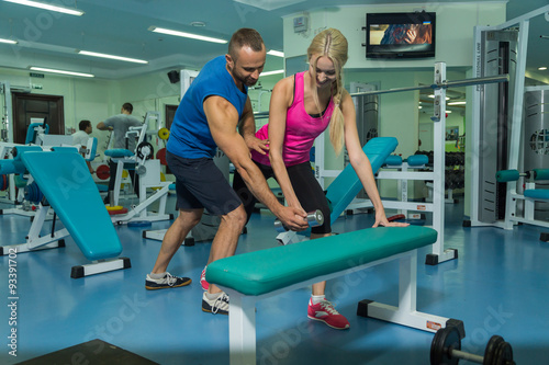 a09009c3ab7 Sporting a young couple in the gym. Healthy Lifestyle. Women s and Men s  Fitness. Work on your body. Photos for sporting magazines