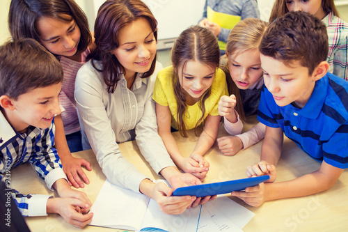 Fotografie, Tablou  group of kids with teacher and tablet pc at school