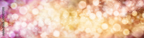 Fototapeta Beautiful autumnal bokeh sparkly website header - Wide multicolored bokeh background with a random scattering of different sized sparkles meandering from left to right obraz