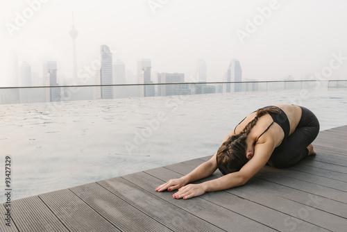 Canvas Prints Kuala Lumpur Woman Doing Yoga in a Big City