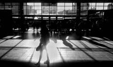 Lady Walking On The Trainstation