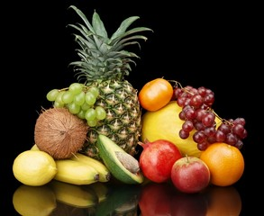 FototapetaGroup of many fruits-grapes,pomegranate,avocado isolated on blac