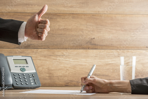Businessman expressing his approval by making a thumbs up gestur Wallpaper Mural