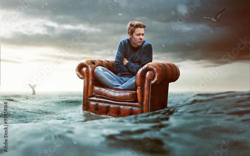 Fotografie, Obraz  Man on a seat lost at sea