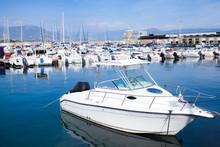 White Motor-boat Floats Moored...