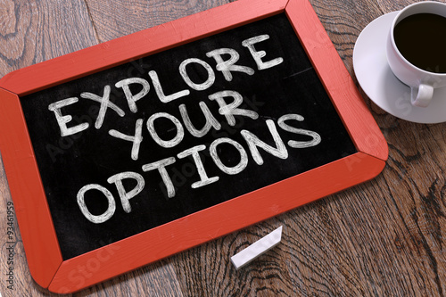 Photo  Handwritten Explore Your Options on a Chalkboard.
