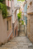 Fototapeta Uliczki - Narrow street and stairs in the Old Town in Dubrovnik, Croatia