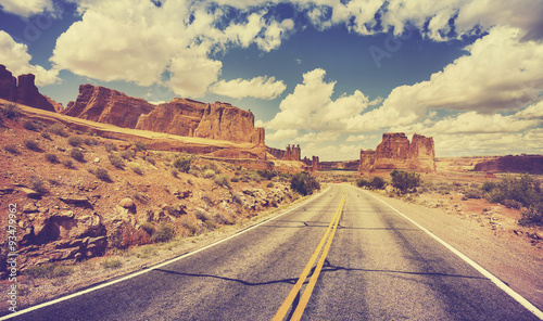 Vintage retro stylized scenic desert road, USA.