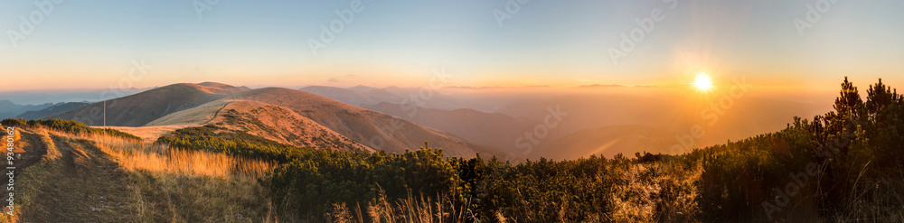 Fototapeta Panorama of amazing sunrise on mountain ridge