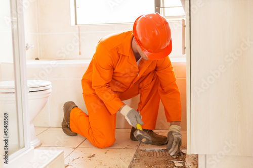 Constructon Worker Removing Old Floor Tiles Buy This Stock Photo