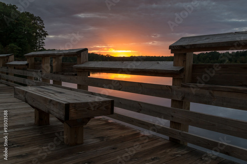 Fotografie, Obraz  View of empty bench with sunset in the background