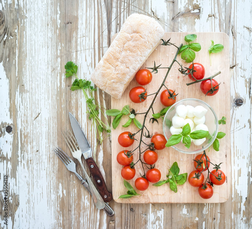 Keuken foto achterwand Ciabatta bread with banch of cherry-tomatoes, basil and