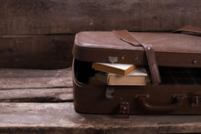 Old Leather Suitcase With Books.