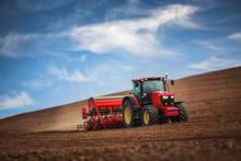 Farmer With Tractor Seeding Cr...