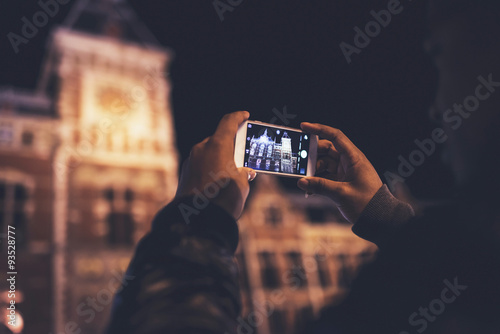 Close-up of male hands photographing architecture with mobile. Wallpaper Mural