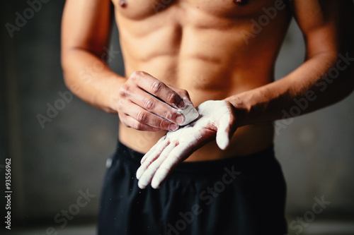 Close-up photo of a climber putting talc on his palms Wallpaper Mural