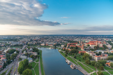 FototapetaRoyal castle on the Wawel hill and Krakow old town - aerial view