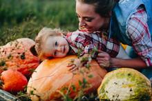 Daughter Lying On A Pumpkin