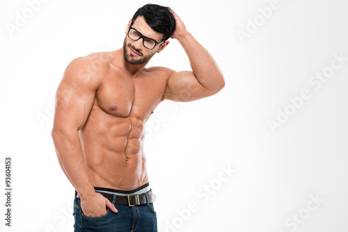Fotografie, Obraz  Thoughtful muscular man in glasses looking away