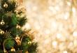 Leinwandbild Motiv Christmas tree background with gold blurred light
