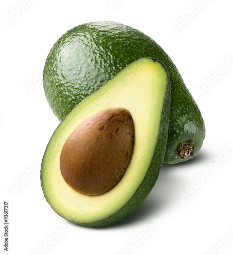 Fotografiet Whole avocado cut half isolated on white background