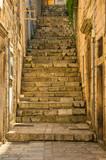 Fototapeta Fototapety na drzwi - Narrow street and stairs in the Old Town in Dubrovnik, Croatia, Mediterranean ambient