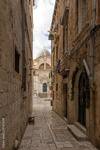 Acrylic Prints Narrow alley Narrow and empty alley and Church of Saint Blaise (Blasius) at the Old Town in Dubrovnik, Croatia.