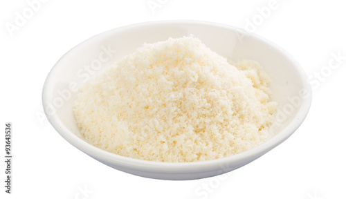 Fotografie, Obraz  Grated cheese in a white bowl over white background