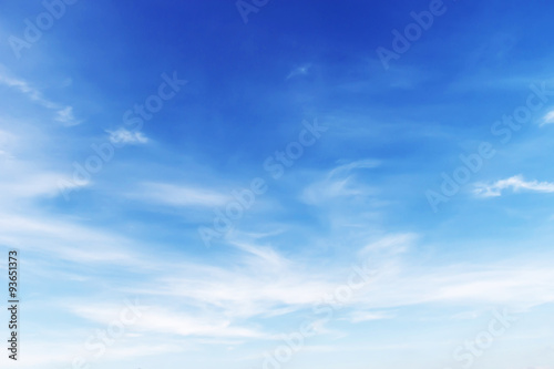 Fotografering  Fantastic soft white clouds against blue sky background