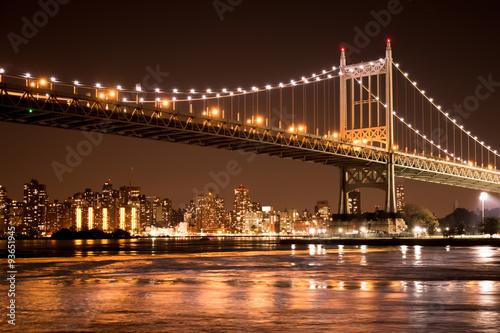 Beautiful view of the Ed Koch Queensboro Bridge in New York City looking towards Manhattan at night