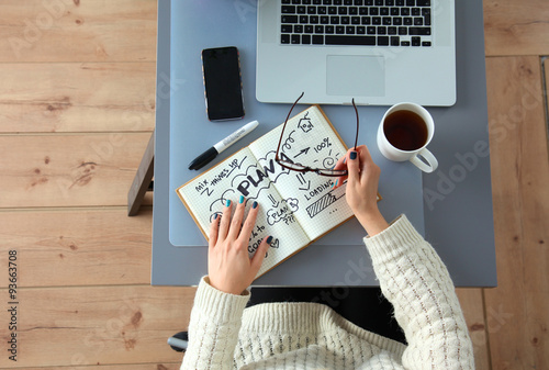Designer working at desk using digitizer in his office - Buy