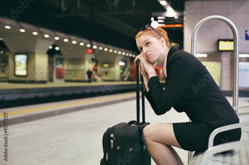 Fotografie, Obraz  Bored businesswoman waiting train