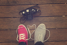 Young Happy Couple In Love With Their Shoes.