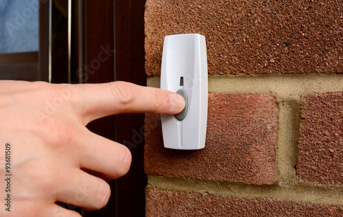 Vászonkép Close-up of woman pressing a doorbell