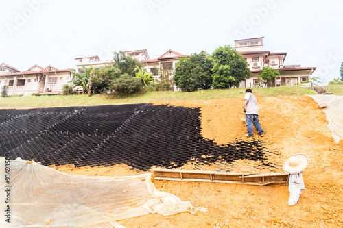 Slope erosion control with grids and earth on steep slope Fototapet