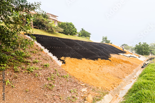 Slope erosion control with grids and earth on steep slope Fototapeta